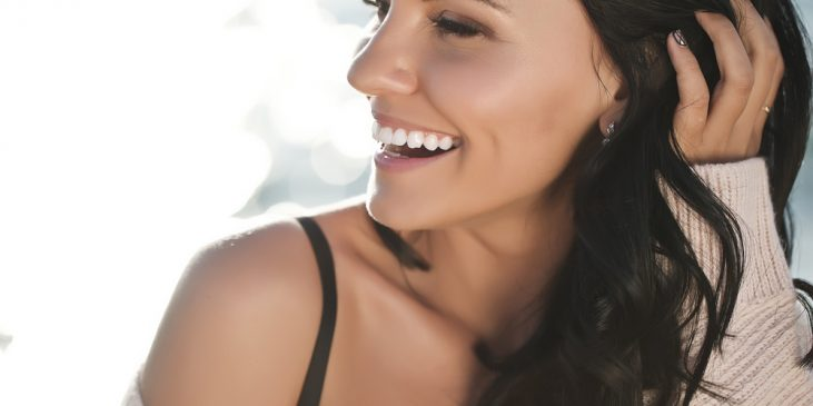 Woman smiling with healthy skin