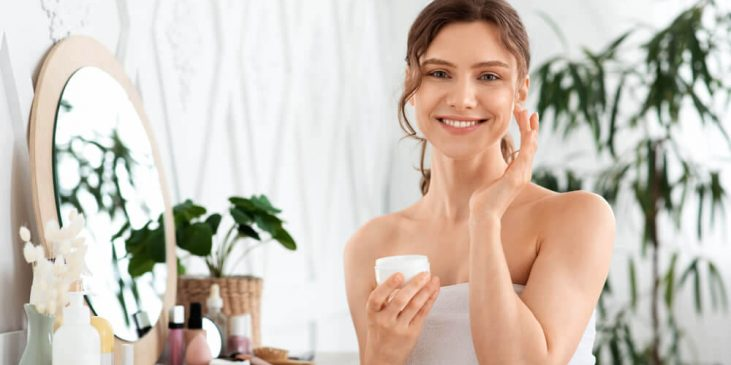 Woman using skin care products