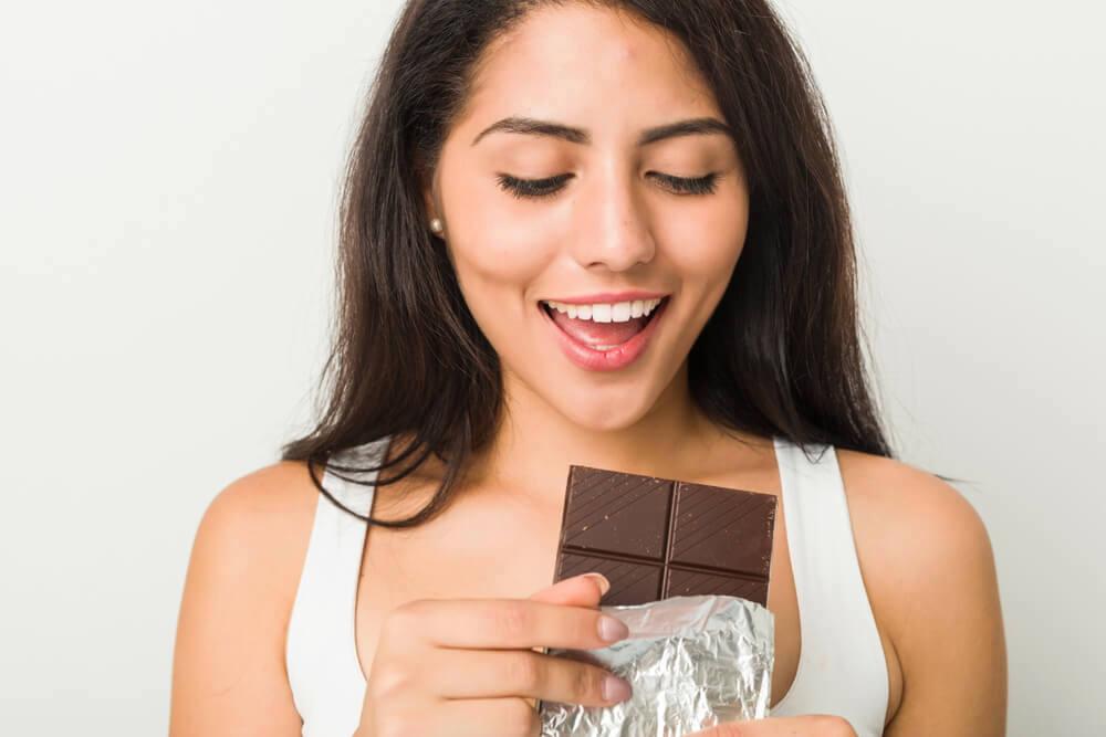 Woman eating dark chocolate