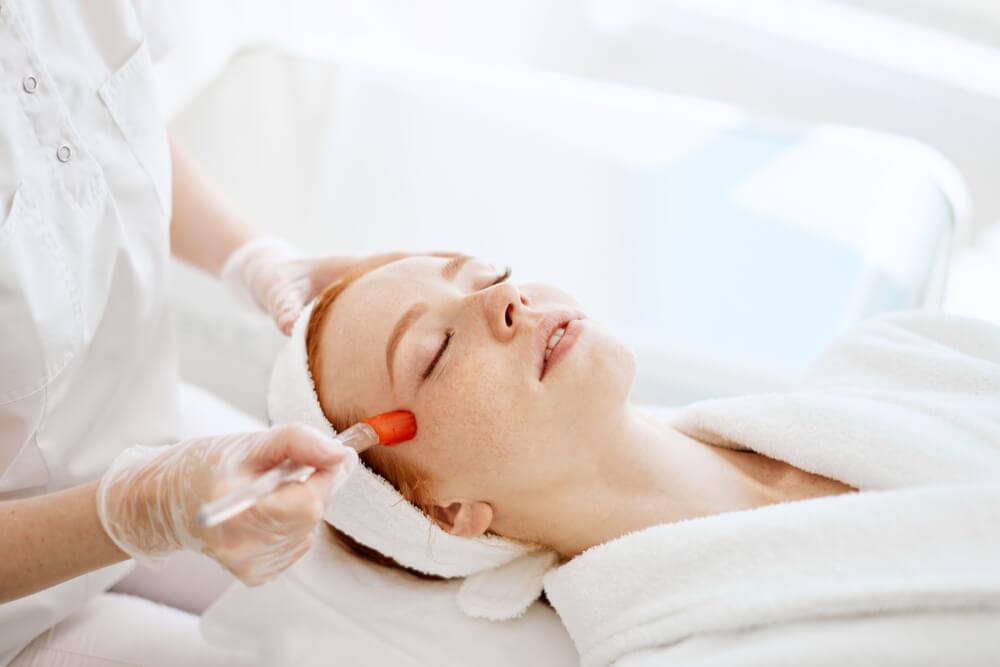 Woman having laser treatment